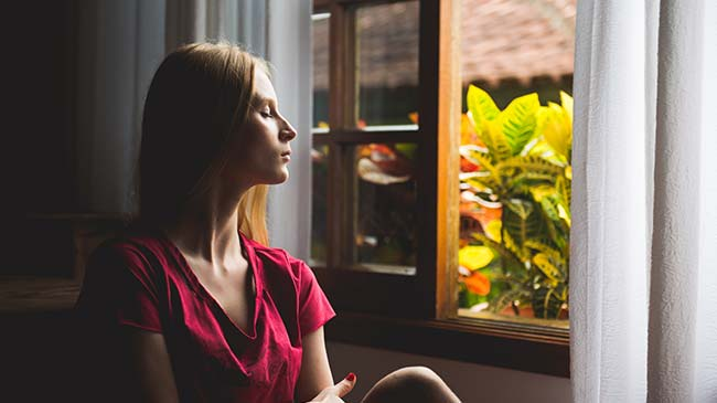 Teen girl enjoying the world outside her window