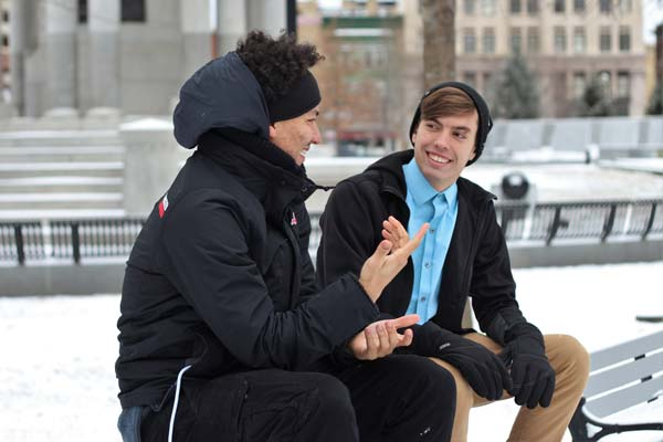 Teen boys chatting in the snow