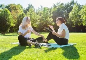Teen and therapist in park