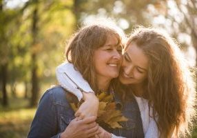 Mother and daughter hugging outside residential treatment center